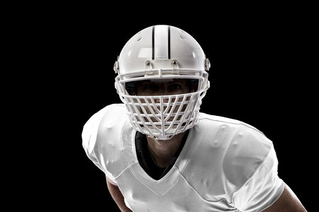 Close up of a Football Player with a white uniform on a black background. Stock Photo