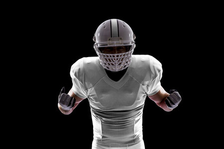 Football Player with a white uniform on a black background. Stock Photo