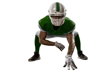Football Player with a Green uniform on the scrimmage line, on a white background.
