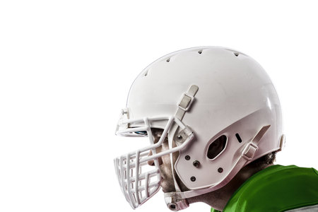 Close up of a Football Player with a Green uniform on a white background.