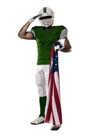 Football Player with a Green uniform saluting with a american flag, on a white background.