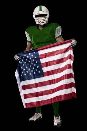 Football Player with a Green uniform and a american flag, on a black background. Stock Photo