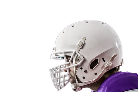 Close up of a Football Player with a purple uniform on a white background.