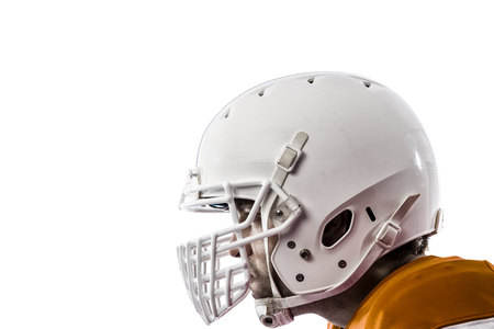 Close up of a Football Player with a orange uniform on a white background.