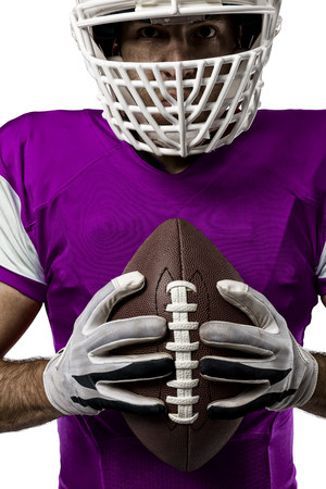 Close up of a Football Player with a pink uniform on a white background.
