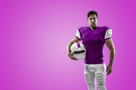 Football Player with a pink uniform on a pink background.