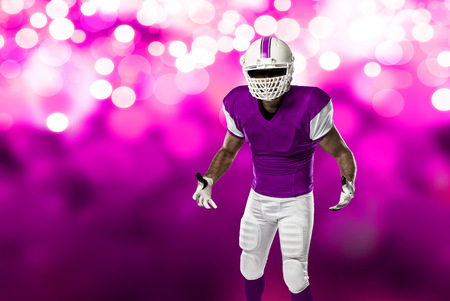 Football Player with a pink uniform on a pink lights background.