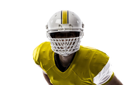 Close up of a Football Player with a yellow uniform on a white background.