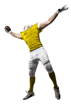 Football Player with a yellow uniform making a catching on a white background.
