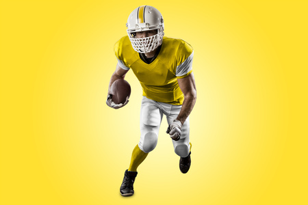 Football Player with a yellow uniform Running on a yellow background.