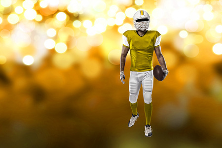 Football Player with a yellow uniform on a yellow lights background.