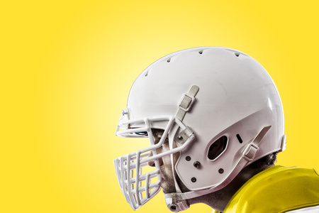 Close up of a Football Player with a yellow uniform on a yellow background.