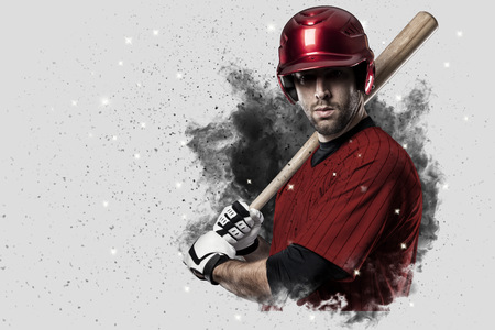 Baseball Player with a red uniform coming out of a blast of smoke .