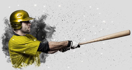 Baseball Player with a yellow uniform coming out of a blast of smoke .