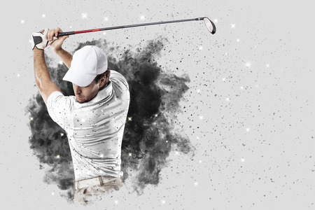 Golf Player with a white uniform coming out of a blast of smoke . Banque d'images