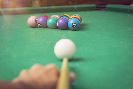 Man playing billiards in a pool table.