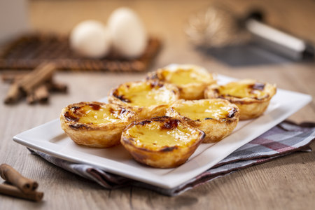 Typical Portuguese custard pies - Pastel de Nata or Pastel de Belem. traditional portuguese pastry. 版權商用圖片