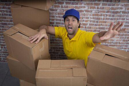 Brazilian mailman lost in a lot of boxes in a deposit