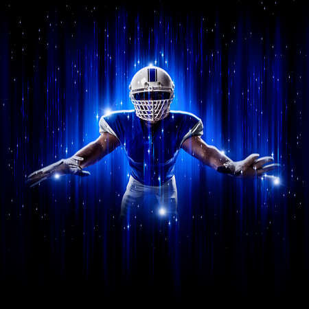 Football Player player with a superhero pose wearing a blue uniform on a black background with blue lights.
