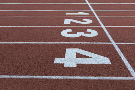 lanes on a running track with the numbers one to four
