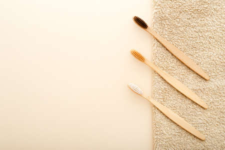 Eco-friendly bamboo tooth brush. Zero waste set on light beige natural background. Flat lay style