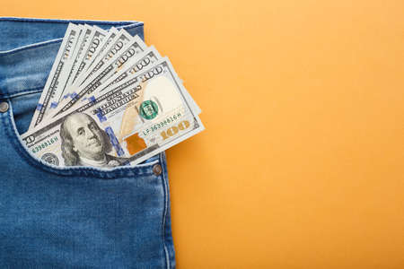 dollars in a jeans pocket, closeup 写真素材 - 129857170
