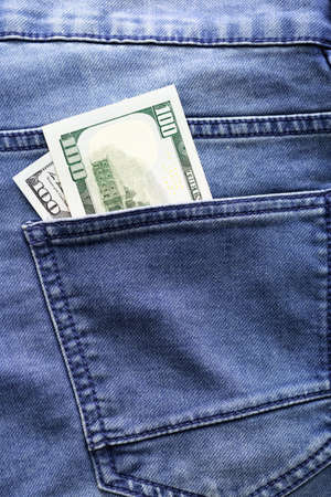 dollars in a jeans pocket, closeup 写真素材 - 129857175