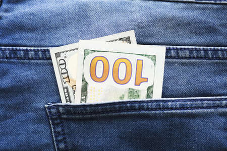 dollars in a jeans pocket, closeup 写真素材 - 129857193