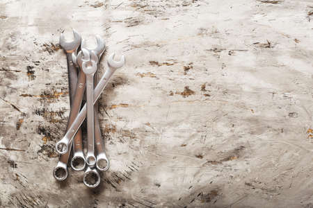 Spanners. Many wrenches. Industrial background. Set of wrench tool equipment. Set of wrenches in different sizes on grey background. Top view with copy space Banque d'images