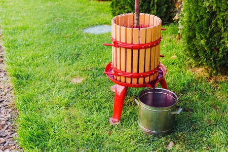 Winepress machine, Crusher. Grape harvest. Special equipment for the production of wine, winemakingoutdoors with copy space. Concept of small craft business, home made wine. Autumn winery.