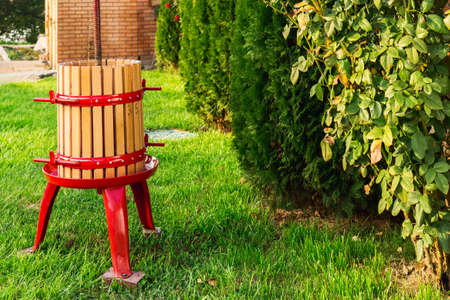 Winepress machine, Crusher. Grape harvest. Special equipment for the production of wine, winemakingoutdoors with copy space. Concept of small craft business, home made wine. Autumn winery