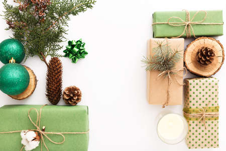 Zero waste Christmas composition background made of pine cones, branches, candle, tree rings, crafted gifts with no plastic on white table. Top view, close up, copy space, background, flat lay Stock fotó