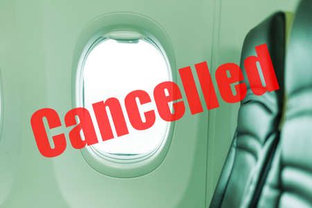 Flight cancelled. Coronavirus, red warning sign with text cancelled Flight in empty airplane cabin. Cancelled flight, no travel, stop airline for prevention coronavirus pandemic. COVID19 quarantine.