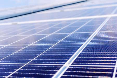 Solar panels on house roof. Solar energy power. Sun electricity technology. Stock photo solar panels as a background. Alternative energy ecological concept