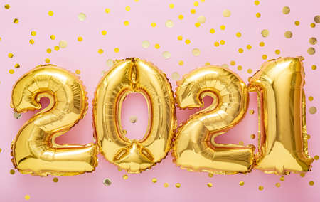 2021 Happy New year eve invitation. 2021 Golden air balloon numbers on pink background with confetti