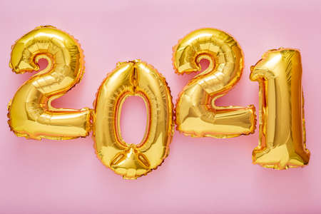 2021 balloon text on pink background. Happy New year eve invitation with Christmas gold foil balloons 2021. Flat lay long web banner