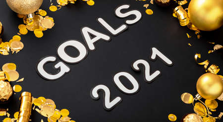 Goals 2021 text lettering on black background in frame made of gold Christmas festive decor. New year 2021 goals, resolution check list wishlist. Long web banner Banco de Imagens