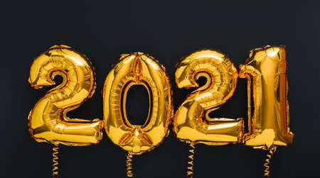 2021 year Christmas gold air balloons on black background. Happy New year 2021 eve. Long web banner
