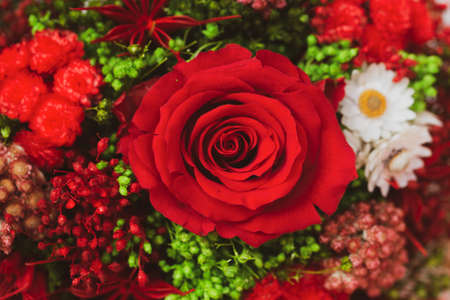 bouquet of dried flowers with red rose on white background Stock Photo