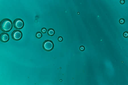 background air bubble out of bluecolored liquid Stock Photo