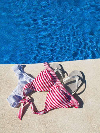 femal swimsuit left at pool edge