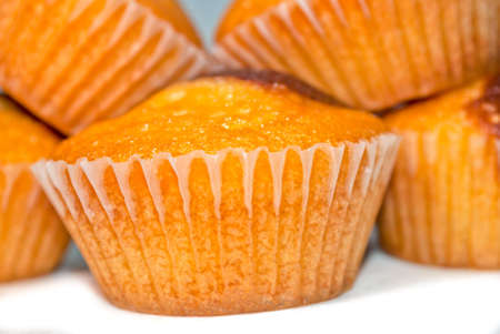 caption: Caption of homemade muffins, isolated on white Stock Photo