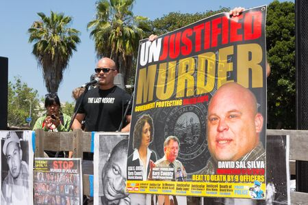 consequence: Los Angeles, CA, USA - April 14, 2015:  Man speaking about murdered family member during Stop Murder by Police. Protest against the brutalization and murdering of black and latino people by police for decades without consequence.