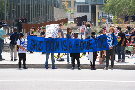 decades: Los Angeles, CA, USA - April 14, 2015:Kids holding banner during Stop Murder by Police. Protest against the brutalization and murdering of black and latino people by police for decades without consequence.