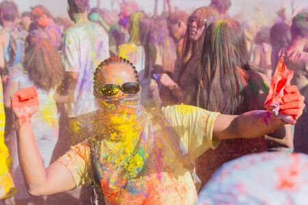 face covered: Norwalk, California, USA - March 7, 2015: Unknown man face covered during the Holi Festival of Colors.