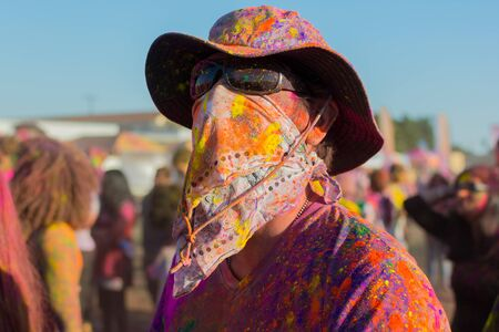 face covered: Norwalk, California, USA - March 7, 2015: Unknown man withwith face covered during the Holi Festival of Colors.