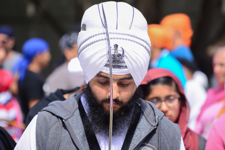 recite: Los Angeles, CA, USA - April 5, 2015: Devotee Sikh with white turban recite prayer at the Anniversary of Baisakhi celebration. Editorial