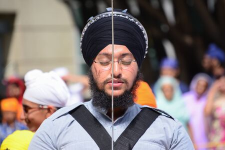 recite: Los Angeles, CA, USA - April 5, 2015: Devotee Sikh with black turban recite prayer at the Anniversary of Baisakhi celebration. Editorial