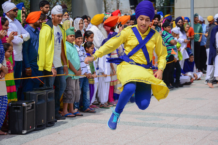 sikh: Los Angeles, CA, USA - April 5, 2015: Devotee Sikh dancing at the Anniversary of Baisakhi celebration. Editorial