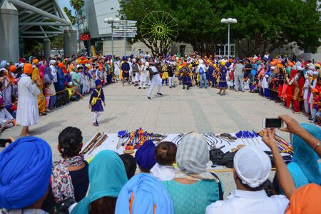 devotee: Los Angeles, CA, USA - April 5, 2015: Devotee Sikhs dancing at the Anniversary of Baisakhi celebration.
